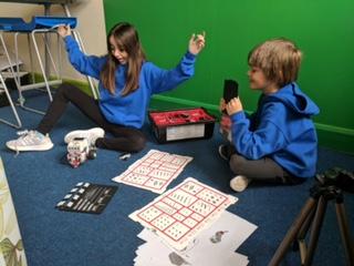 children playing board games - girl celebrating